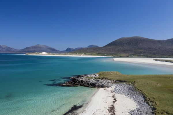 The white coral sand beaches at Luskentyre in Harris, Western Isles, Scotland. In the background are the hills of Harris