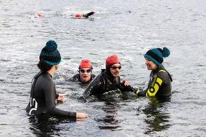 scotland/highland region ross cromarty/swimmer finishing first leg 2014 celtman triathlon